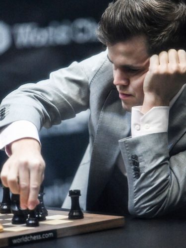 Magnus Carlsen competes against Fabiano Caruana in the World Chess Championship, London, UK