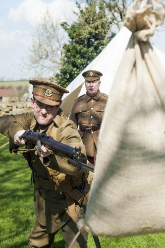 Renactors portraying the Cheshire Regiment undertake training behind the Elm Tree Pub before they take part in a reenactment in Elmton in June. Ed Wilson Practicing with fixed Bayonet under the instruction of corpral Stuart Oden-Walder (right); 20 April  2013 Image © Paul David Drabble