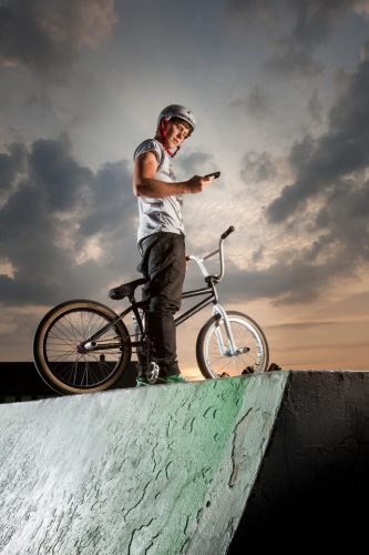BMX rider Keegan Walker practicing his skills at the Ringwood skate park in the evening after work