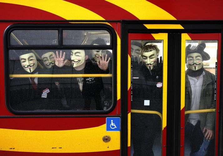 Protestors arrive by bus to join an anti-Scientology demonstration outside the Church of Scientology in London
