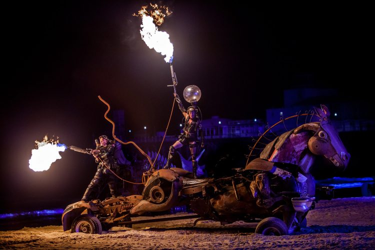 Joe Rush and the Mutoid Waste Company take part in a spectacular show on the beach during the Bournemouth Arts by The Sea Festival.