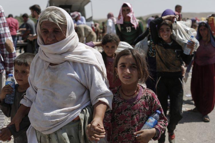 Yazidi refugees flee to Iraqi Kurdistan.