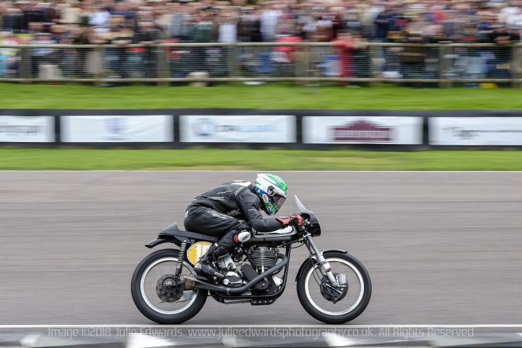 Motorcycle at speed at Goodwood Revival, Goodwood Motor Circuit