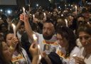 England, UK . 16.6.2017. London . Grenfell Tower fire. Torchlight vigil with family and friends of the dead and missing, here the family of Jessica Urbano.