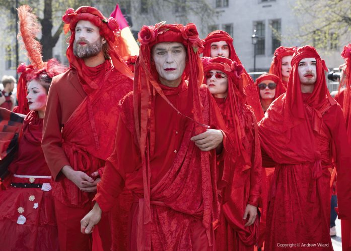 England, UK . 15.4.2019. London. Parliament Square. The Red Brigade perform in a ceremony and funeral procession for extinct and endangered creatures as Extinction Rebellion blocks five London landmarks.
