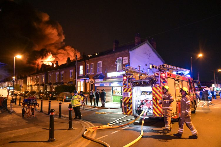 HOMES EVACUATED AS HUGE INFERNO RIPS THROUGH PALLET FACTORY IN BIRMINGHAM