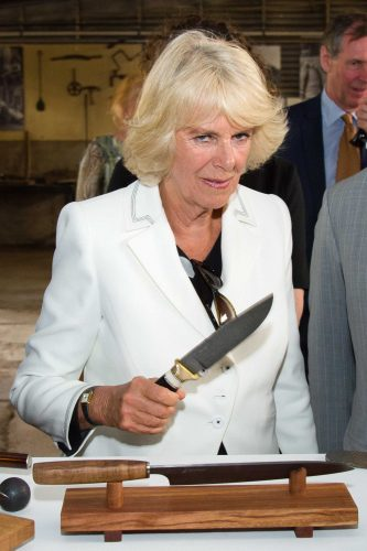 Don't mess with The Duchess.Camilla Duchess of Cornwall brandishes a knife on a visit to Seppeltsfield Winery Australia