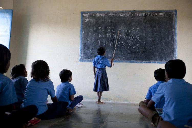 Learning Roman letter alphabet at a girls' boarding school in Rajahstan, India.