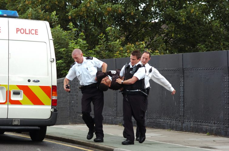 A suicidal man is detained by the police, Ilford. London.