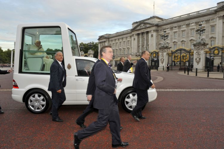 The Pope drives past Buckingham Palace on a recent visit to London.