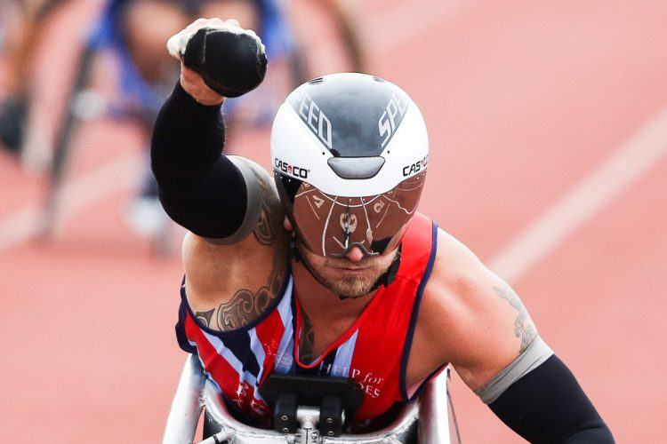 Joseph Townsend of Team GB wins the Men's 100m Wheelchair IT4 race during the Invictus Games. London 2014.