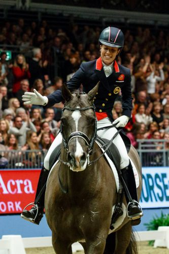 Charlotte Du Jardin riding Valegro breaks the Grand Prix Dressage Freestyle at the London International Horse Show, Olympia 2013.