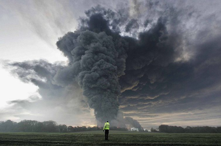 Smoke rises from a fire at the Buncefield fuel depot on December 11, 2005 in Hemel Hemstead, England.