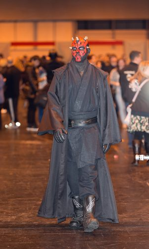Cosplayer at Birmingham Comic Con dressed as Darth Maul from the Star Wars films