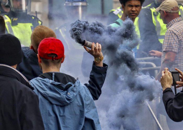 Protestor throws smoke grenade during DFLA & BLM protest