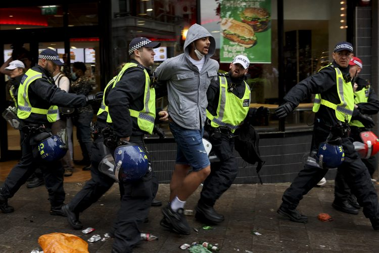 Football fans clash with the police in Leicester Square prior to the England vs Italy game at UEFA EURO 2020, London