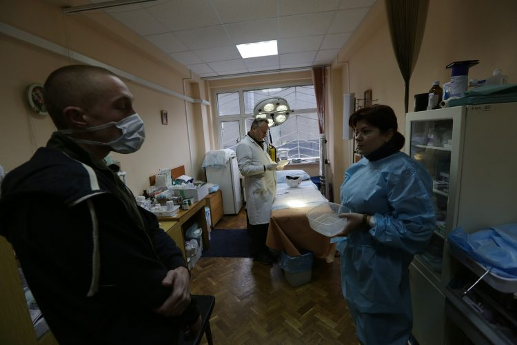 Euromaidan: Protestor waits for treatment in a make shift Hospital Trade Union House, Kiev
