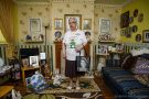 A 78-year-old woman stands amongst her extensive collection of Princess Diane memorabilia filling her home
