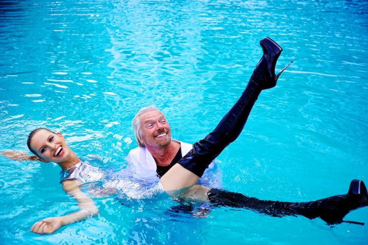Sir Richard Branson throws supermodel Karolina Kurkova into the hotel swimming pool whilst Virgin Atlantic celebrates 25 years of flying between London and Miami. Mondrian Hotel, Miami Beach, Florida, USA.