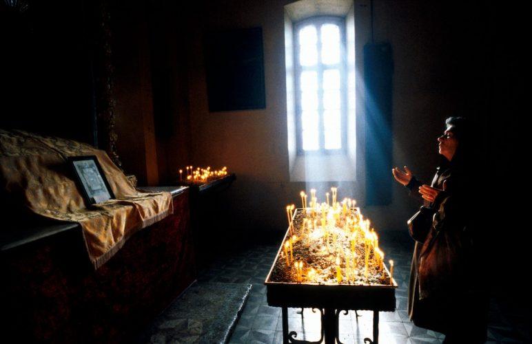 Dear God. A woman prays for the souls of those who died in the Armenian earthquake. Gyumri, Armenia.