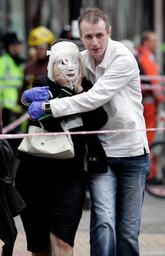Paul Dadge helps Davinia Turrell to safety after emerging from Edgware Road Underground Station. A suicide bomber blew himself up on a tube train at the station, killing seven passengers. This was one of four terrorist attacks on the transport system, resulting in 52 innocent deaths. London, 7 July 2005.