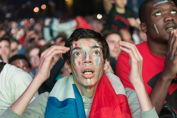 Eiffel Tower Fan Zone, Paris, France. 10th June, 2016. French supporters watch with trepidation the big screen at the Eiffel Tower Fan Zone as Romania's Bogdan Stancu takes a penalty.