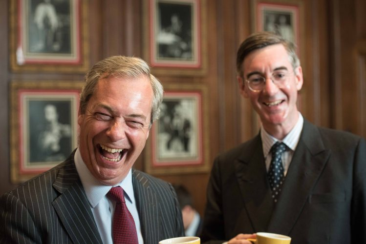 King George and Queen Mary Room, London Marriott County Hall, London County Hall, London, UK. 17th May 2016. UKIP Leader Nigel Farage MEP, Conservative MP Jacob Rees-Mogg as well as EAW victim/ survivor Deborah Dark attend a Bruges Group event focusing on the issues surrounding the European Arrest Warrant. Pictured: Nigel Farage and Jacob Rees-Mogg share a hot drink before their speeches at the Bruges Group event.
