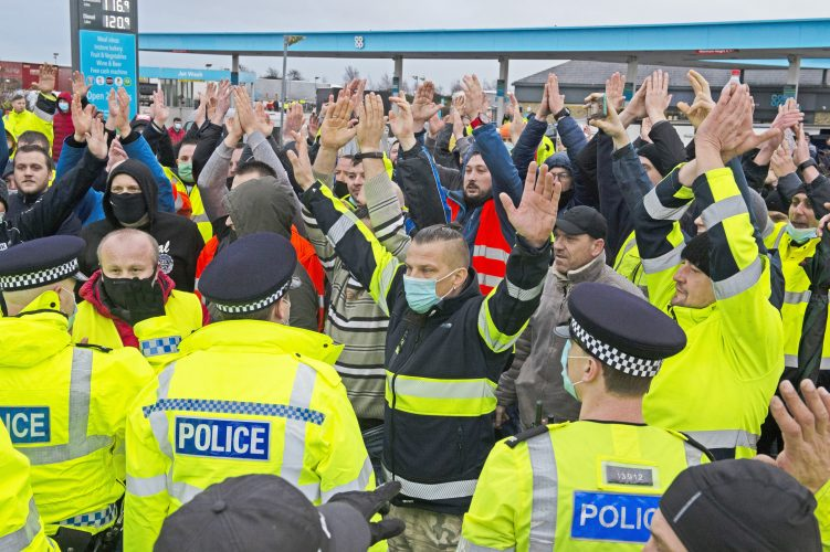 Truckers at Manston Airport clash with police in Kent.