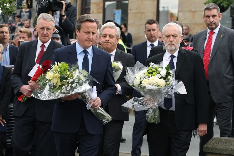 Hilary Benn, MP for Leeds Central, David Cameron, Prime Minster and leader of the Conservative Party, John Bercow, Speaker of the House of Commons, and Jeremy Corbyn, Leader of the Labour Party, arrive at Birstall Market Place, in Birstall, to lay flowers at the Joseph Priestley Statue, following the death of Labour MP, for Batley and Spen, Jo Cox, aged 41, who was shot and stabbed yesterday, in Birstall, West Yorkshire.