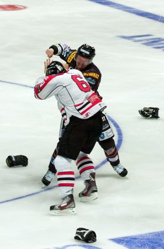 A fight breaks out between two rival ice hockey players, during a Challenge Cup game between the Sheffield Steelers and the Cardiff Devils.