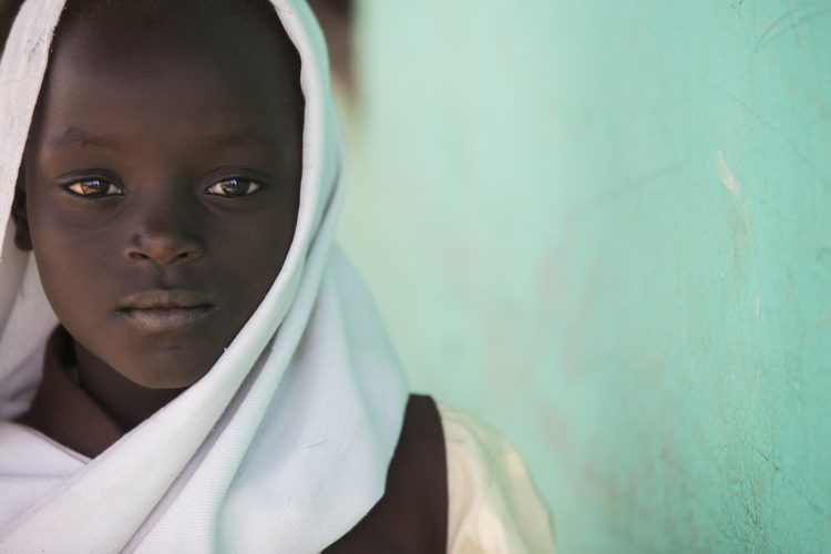 A young Moslem girl in southern Sudan attends a boarding school run by three Catholic priests, and funded by the Qatari charity Education Above All in a region torn by religious conflict.