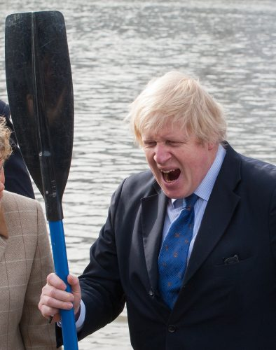 Mayor of London Boris Johnson yawns during a photo call at Westminster Boating Base, Grosvenor Road.