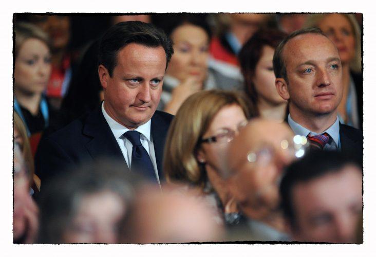 PM, David Cameron listens to Boris Johnson speech.