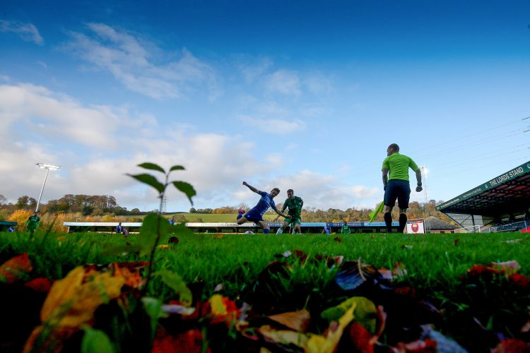 General view of action among Autumn leaves at Adams Park.