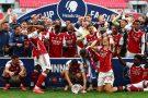 Players react as Pierre-Emerick Aubameyang of Arsenal drops FA Cup.