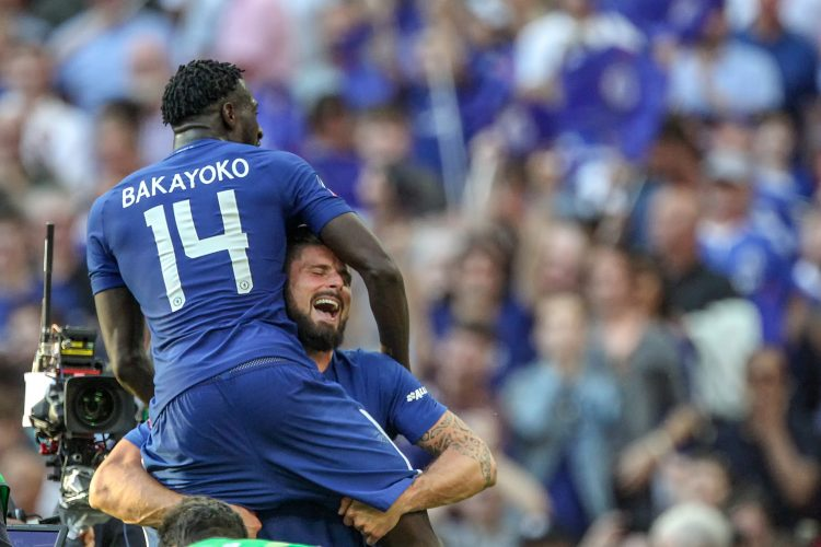 Chelsea's Tiemoue Bakayoko and Olivier Giroud celebrate after winning the FA Cup Final against Manchester United at Wembley Stadium, London