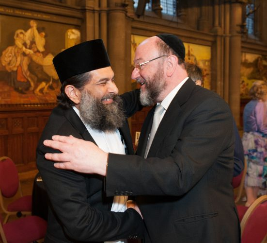 A warm embrace between Chief Rabbi Ephraim Mirvis and Shaykh Ibrahim Moira - 2015