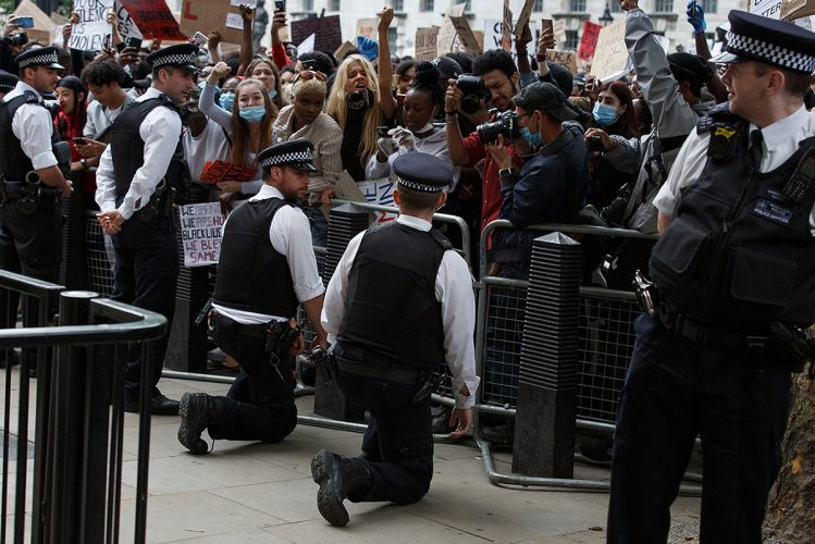 Police take  the knee outside Downing St at the first 'Black Lives Matter' protest in London
