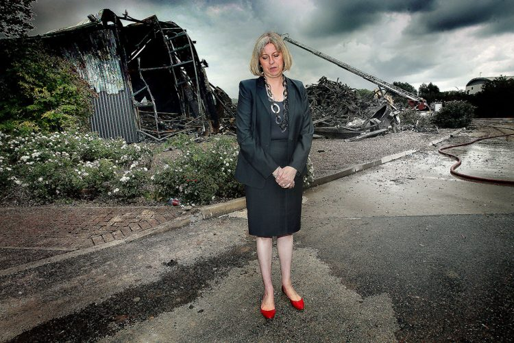 Home Secretary Theresa May visiting Sony fire warehouse.NL26825