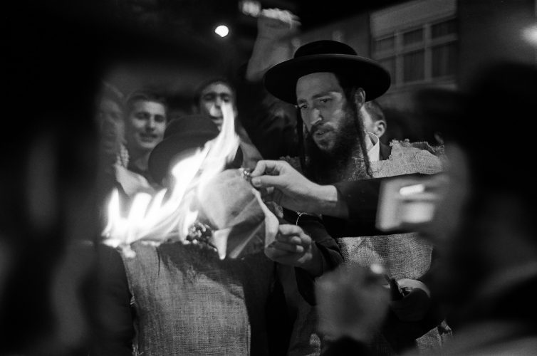 A member of the Orthodox Neutrei Karta sets light to an Isreali Flag whilst protesting outside a Zionist Federation Conference...
