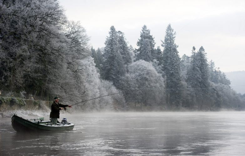 An angler casts on the opening day of the Salmon fishing season on a very cold and frosty River Tay.