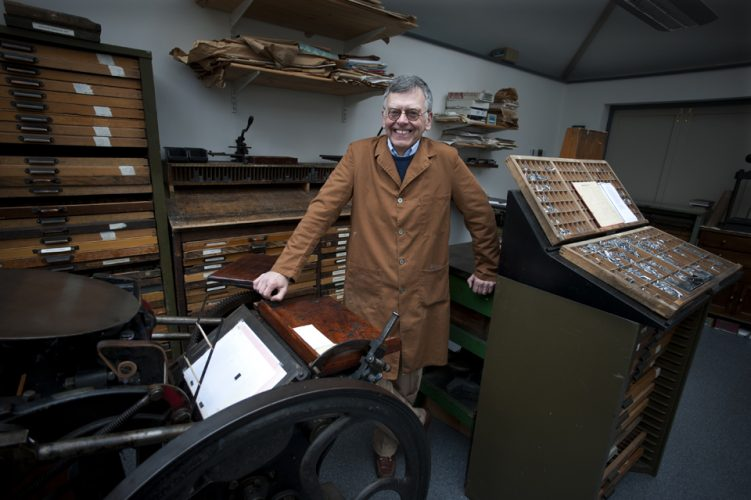 Professor 'Chip' Coakley with his printing presses at his home i