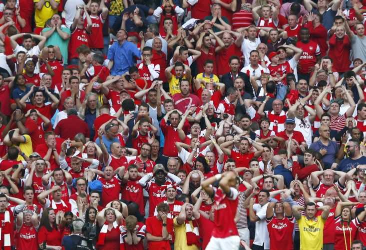 Arsenal fans react after Arsenal's Gibbs missed a chance to score during their FA Cup final soccer match against Hull City at Wembley Stadium in London