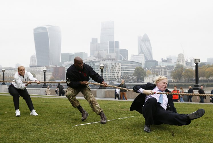 London Mayor Johnson takes part in a tug of war with members of the armed services to launch the London Poppy Day, outside City Hall, in London