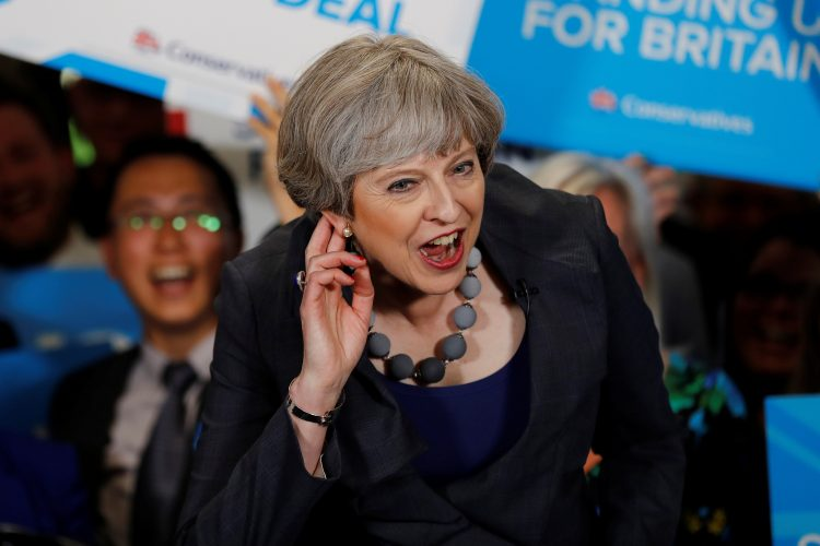 Britain's PM May reacts as she speaks at an election campaign event at Pride Park Stadium in Derby