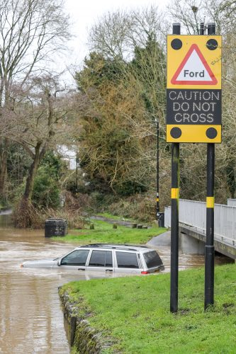 STORM DENNIS FLOODING STOPS 4X4 DRIVER AS CAR SUBMERGED IN BIRMINGHAM