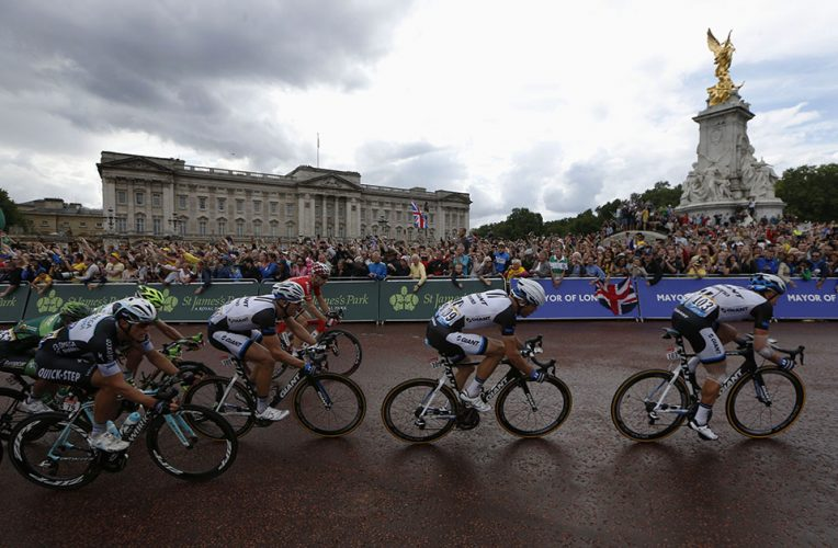 The peloton race pass Buckingham Palace in London during the third stage of the Tour de France cycling race.