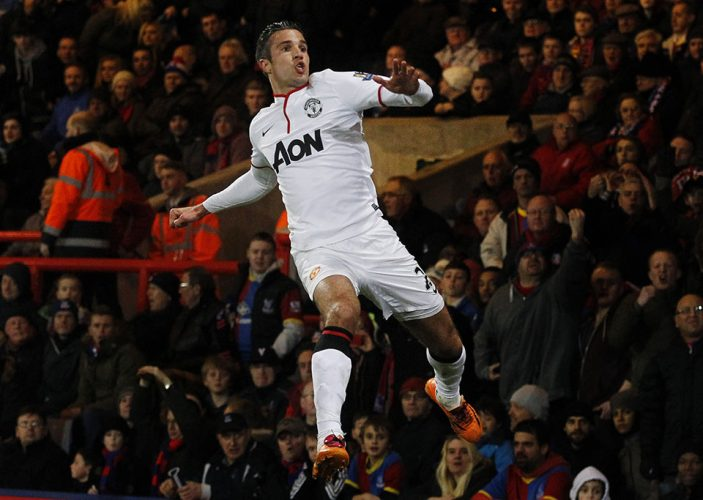 Manchester United's Robin Van Persie celebrates his penalty goal against Crystal Palace during their English Premier League soccer match at Selhurst Park, London.