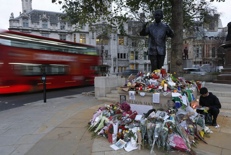 Floral tributes left at the statue of Nelson Mandela in Parliament Sqaure in London in tribute to Mandela, 95, who passed away after a long illness.