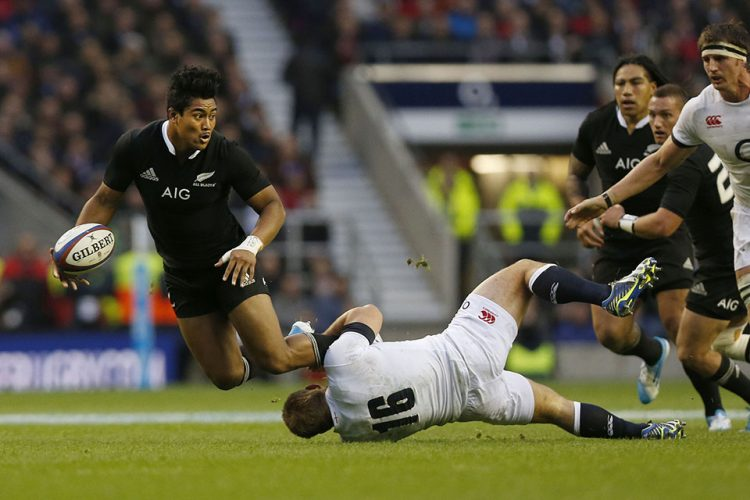 New Zealand's Julian Savea, left, is tackled by England's Tom Youngs during their autumn international rugby match at Twickenham Stadium in London.